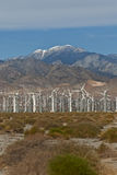 Wind Turbines. Wind Turbine farm located on California desert surrounded by mountains Royalty Free Stock Images