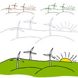 Wind Turbines. An image of a wind turbines in a field with the setting sun Stock Photos