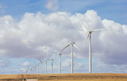 Wind Turbines. In a row against cloudy sky Stock Photo