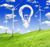 Wind turbines. With bulb from clouds Stock Images