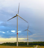 Wind turbines. Agriculture landscape with wind turbines, by Beckingen, Saarland - Germany, warm evening sun, stitched - original size Royalty Free Stock Photo