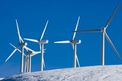 Wind turbines. On snow landscape Royalty Free Stock Image
