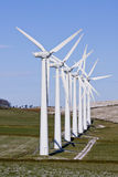 Wind turbines. In line on a windfarm stock image