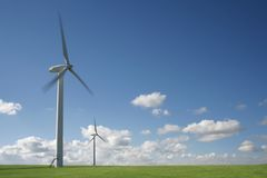 Wind Turbines. Against a blue Sky, with room for text and copy on the right stock photography