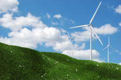 Wind Turbines. On green field. Clean environment concept Royalty Free Stock Image