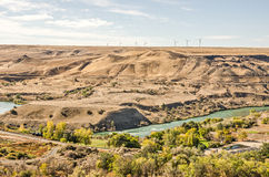 Wind Turbines Above the River Royalty Free Stock Photo