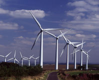Wind turbines adjacent to country lane Stock Image