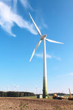Wind turbines against beautiful sky stock photography