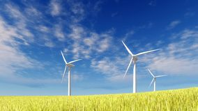 Wind turbines against blue cloudy sky Stock Image