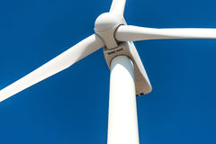 Wind turbines  against a blue sky generating electricity Stock Photo
