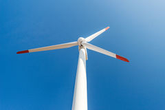 Wind turbines  against a blue sky generating electricity Stock Images