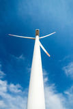 Wind turbines against a blue sky generating electricity royalty free stock photo