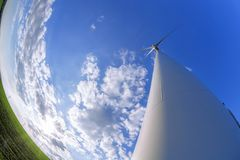 Wind turbines against blue sky during sunrise royalty free stock photo