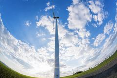 Wind turbines against blue sky during sunrise royalty free stock photography
