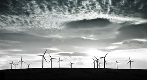 Wind turbines against dramatic clouds Royalty Free Stock Photography