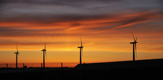 Wind Turbines against Sunset Royalty Free Stock Images