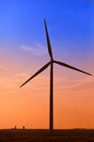 Wind turbines against the sunset sky Stock Images
