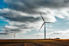 Wind turbines in agricultural land  Stock Photos