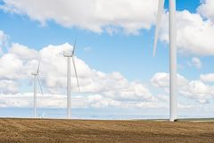 Wind turbines in an agricultural landscape royalty free stock photos