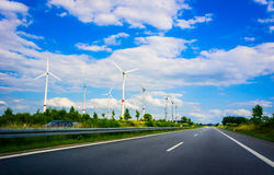 Wind turbines in agriculture landscape Royalty Free Stock Image