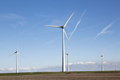 Wind turbines along the dike near the dutch Waddenzee Royalty Free Stock Photo