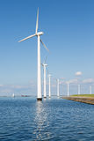 Wind turbines along Dutch coast near Urk. Row of Wind turbines along Dutch coast near Urk Royalty Free Stock Images