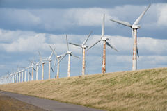 Wind turbines along a Dutch dike near Urk Royalty Free Stock Photo