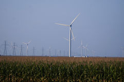 Wind turbines along the highway in the midwest. Royalty Free Stock Photography
