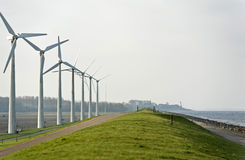 Wind turbines along a lake Royalty Free Stock Images