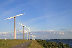 Wind turbines along the lake Royalty Free Stock Image