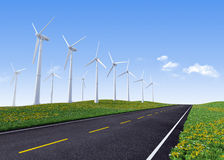 Wind turbines along road Royalty Free Stock Photo