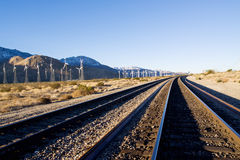 Wind turbines along tracks Stock Image