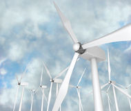 Wind Turbines - Alternative Energy. Several wind turbines against a blue cloudy sky Stock Images