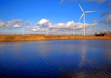 Wind Turbines And Lake Royalty Free Stock Photos