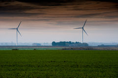 Wind turbines in arable fields Royalty Free Stock Images