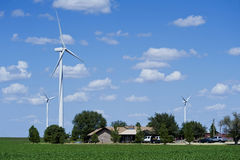 Wind turbines around home Royalty Free Stock Images