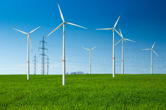 Wind turbines and wiring. Wind turbines as an alternative energy source and high voltage wiring behind Royalty Free Stock Photo