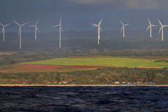 Wind turbines as seen from the Ocean Royalty Free Stock Photography