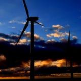 Wind turbines backlit before sunrise Stock Image