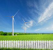 Wind turbines on a beautiful green field Royalty Free Stock Photos