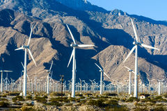 Wind turbines with 3 blades in desert Royalty Free Stock Photo