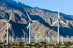 Wind turbines with 3 blades in desert Stock Photos