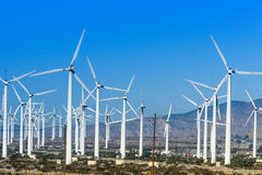 Wind turbines with 3 blades in desert Royalty Free Stock Image