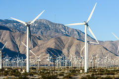 Wind turbines with 3 blades in desert Stock Photo
