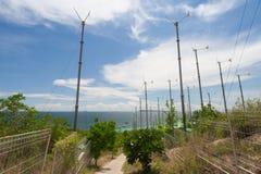 Wind turbines and blue sea. Wind turbines and blue sea Stock Photography