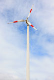 Wind turbines on blue sky Stock Photos