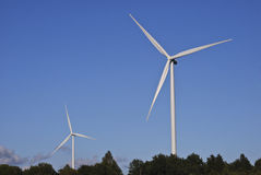 Wind turbines and blue sky. Two wind turbines in countryside with blue sky background Royalty Free Stock Photography