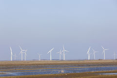 Wind turbines and blue sky above eempolder in the netherlands Stock Images