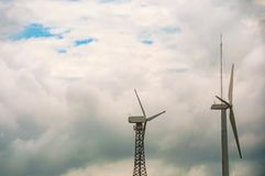 Wind turbines with blue sky and cloud,Wind power station. Ecological energy composition.  royalty free stock photo