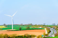 Wind Turbines and Blue Sky with Clouds over UK fields Royalty Free Stock Images
